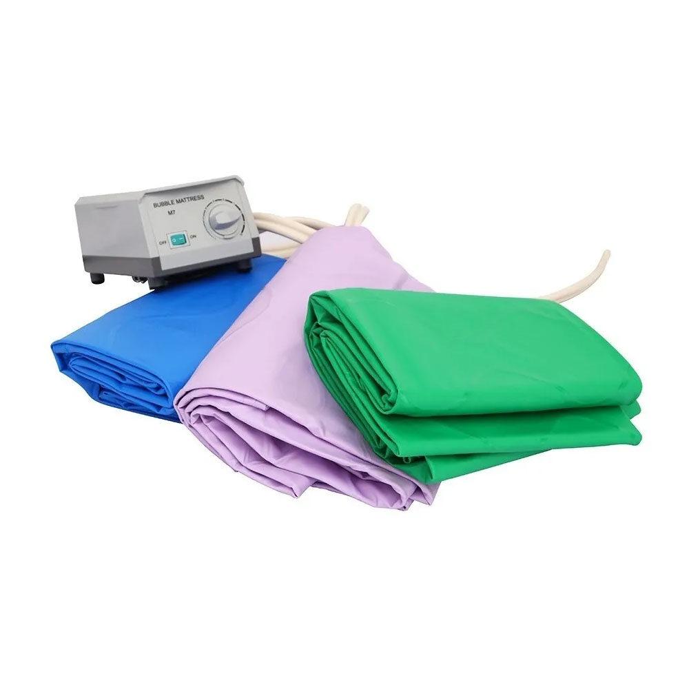 Colchón de presión alterna marca Eko Mobility colores azul, verde y lila ademas de su bomba de compresion